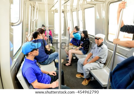 LOS ANGELES, USA - July 10, 2016: J. Paul Getty Museum visitors in a museum tram. A  tram takes you from the street-level entrance to the top of the hill on July 10, 2016, Los Angeles, CA  - stock photo