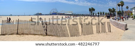 Los Angeles, USA - July 14, 2013: Panoramic View of Santa Monica Beach, Pier & Boardwalk on a hot Summer day.