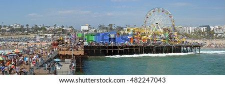 Los Angeles, USA - July 14, 2013; Panoramic View of the Santa Monica Pier & Beach on a very hot Summer day.