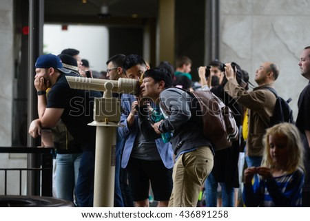 LOS ANGELES, USA - JUNE 11, 2016: Tourists and visitors crowded on observation decks in Hollywood and Highland Center to view the world famous Hollywood Sign in Los Angeles, USA.  - stock photo