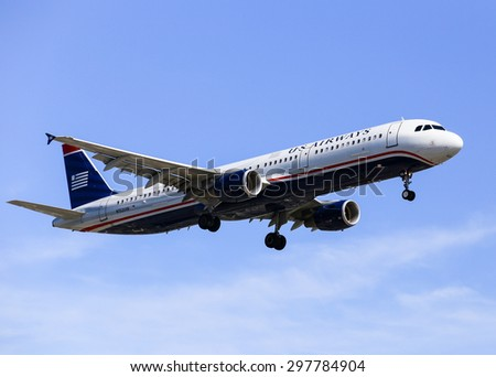 LOS ANGELES, USA - MAY 30, 2015: An airplane of US Airways (Airbus A321) landing at Los Angeles International Airport. - stock photo