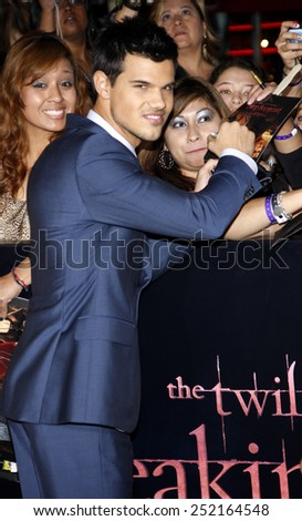 "LOS ANGELES, USA - NOVEMBER 14: Taylor Lautner at the Los Angeles Premiere of ""The Twilight Saga: Breaking Dawn Part 1"" held at the Nokia Theatre L.A. Live in Los Angeles, USA on November 14, 2011. - stock photo"