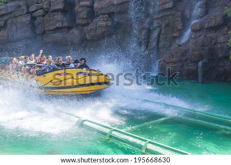 Los Angeles -USA, October, 3: Excited People Taking Boat Water Attraction Sliding from the Steep Slope at Universal Studios in Los Angeles, California, October, 3, 2013, United States - stock photo