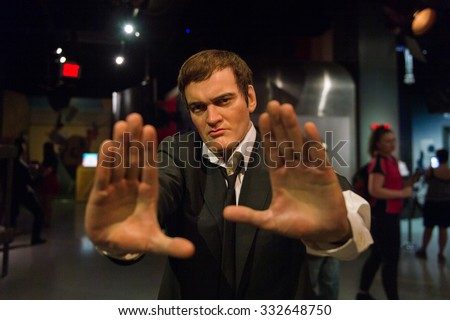 LOS ANGELES, USA - SEP 28, 2015: Quentin Tarantino in Madame Tussauds Hollywood wax museum. Marie Tussaud was born as Marie Grosholtz in 1761 - stock photo