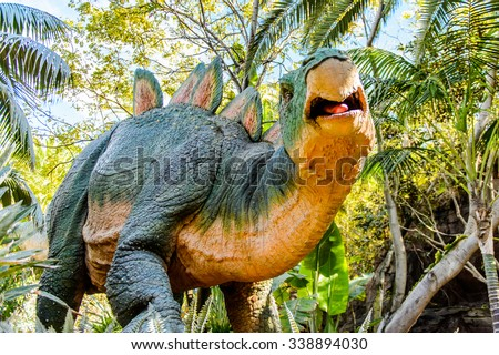 LOS ANGELES, USA - SEP 27, 2015:Stegosaur in  Jurassic Park area in the Universal Studios Hollywood Park. Jurassic Park is a 1993 American adventure film  by Steven Spielberg - stock photo