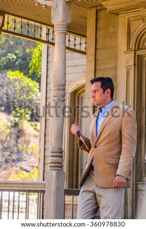 LOS ANGELES, USA - SEP 27, 2015: Unidentified man as Norman Bates with a knife at the Universal Studios Hollywood Park. Psycho is a 1960 film by Alfred Hitchcock - stock photo