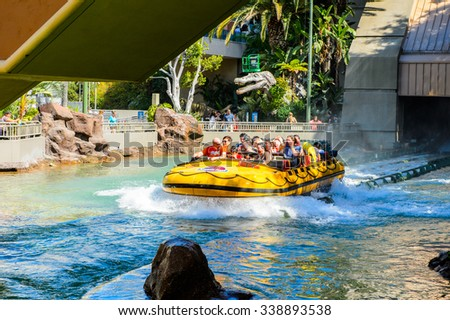 LOS ANGELES, USA - SEP 27, 2015: Water attraction in the Jurassic Park area in the Universal Studios Hollywood Park. Jurassic Park is a 1993 American adventure film  by Steven Spielberg - stock photo