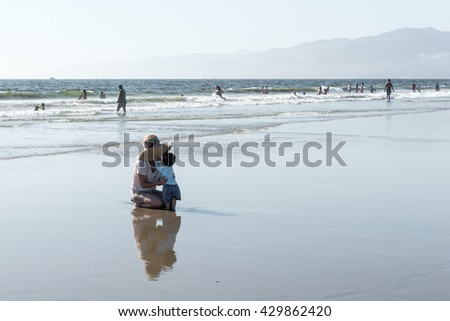 Los Angeles, USA - September 27, 2015: People are walking on Venice beach, California.