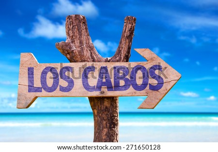 Los Cabos wooden sign with beach background - stock photo