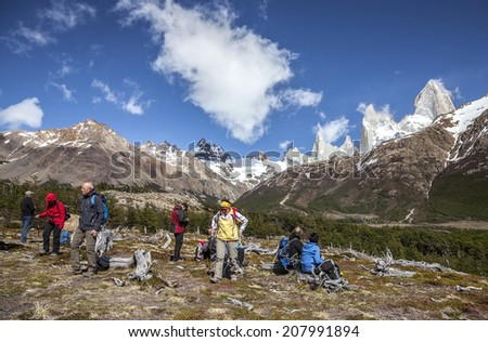 LOS GLACIARES NATIONAL PARK, ARGENTINA - NOVEMBER 08, 2013: Tourists admiring scenic view of Mount Fitz Roy, one of the most beautiful places in Patagonia, Argentina. - stock photo