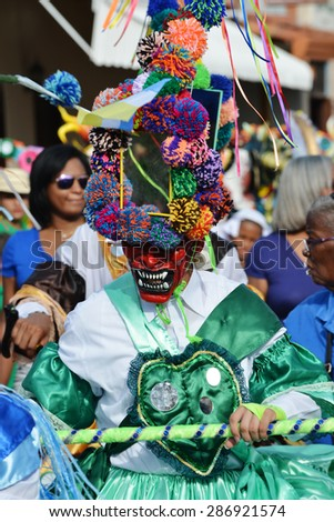 LOS SANTOS,PANAMA-JUNE 13,2015: Corpus Christi Feast celebration in the streets of Los Santos with dancing demons with the colorful hand made masks - stock photo