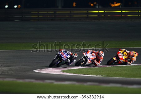 LOSAIL - QATAR, MARCH 20: Spanish Yamaha rider Jorge Lorenzo in the lead at 2016 Commercial Bank of Qatar MotoGP at Losail circuit on March 20, 2016 - stock photo