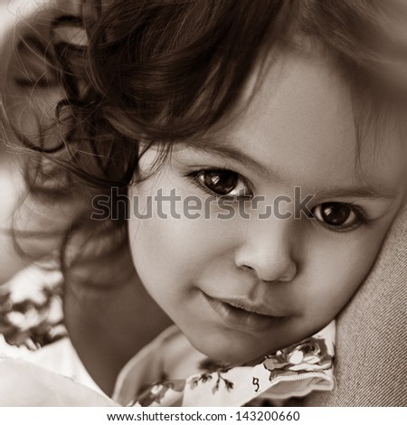 lose-up portrait of a beautiful happy little girl - stock photo