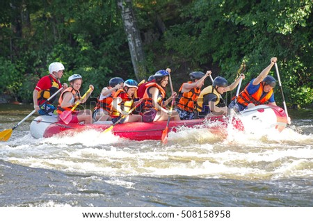 LOSEVO - AUGUST 18: Whitewater rafting on AUGUST 18, 2012 RUSSIA. Unidentified persons enjoy whitewater rafting on the Vuoksi river in Losevo, Leningrad region, Russia
