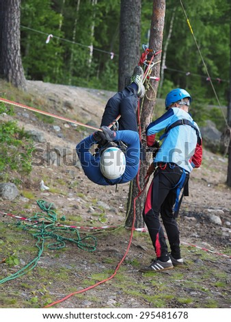 "LOSOSINNOE LAKE, KARELIA REGION, RUSSIA - JUNE 29, 2015: Russian youth competition ""Survival School"" on Lososinnoe lake, Karelia region, Russia."