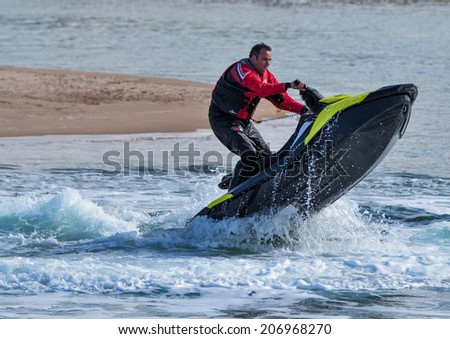 LOSSIEMOUTH, MORAY, SCOTLAND - 17 JULY: This is a scene from Jet Ski activity within the breakwater area of the River Lossie at Lossiemouth, Moray, Scotland on 17 July 2014.