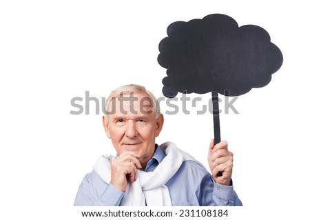 Lost in thoughts. Portrait of thoughtful senior man holding hand on chin and copy space while standing against white background  - stock photo