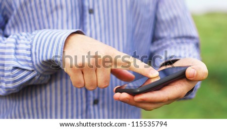 Lost man using mobile smart phone to find the way out - stock photo