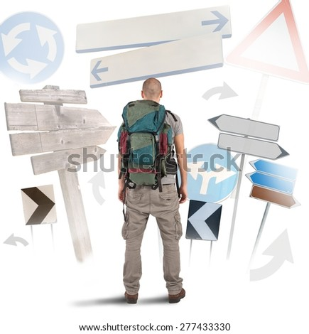 Lost traveler undecided which way to go - stock photo