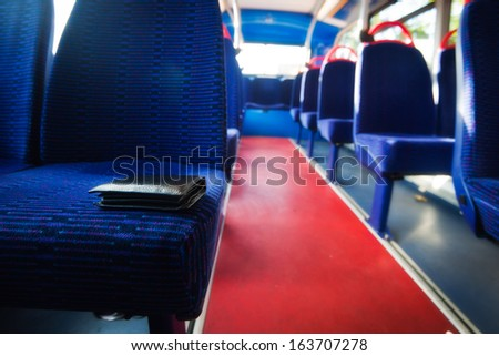 Lost wallet in the bus - stock photo