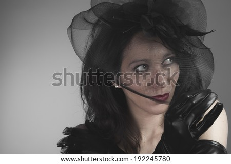 Lost, widow woman with black veil concept of death and loss - stock photo