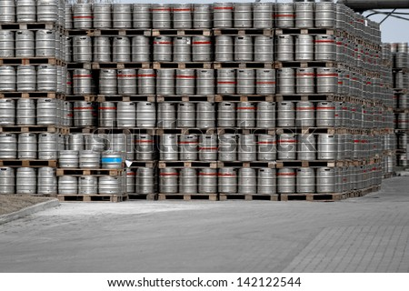 Lot of beer barrels stacked up at the industry - stock photo