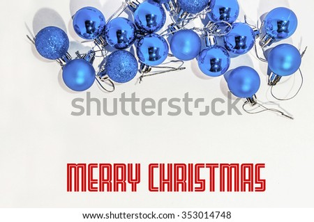 Lot of blue small decorative christmas balls on white