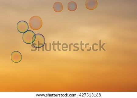 lot of bubbles on the background of sunset sky - stock photo