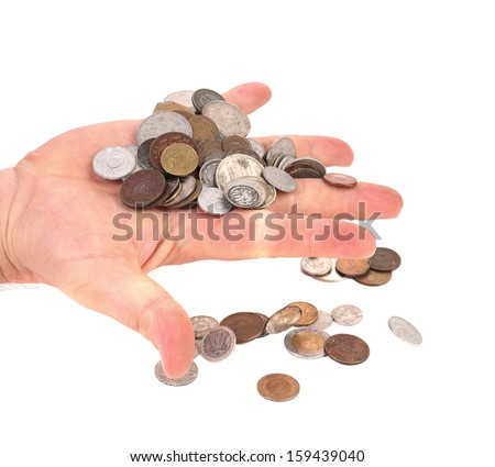 Lot of coins in hand. Isolated on a white backgropund.