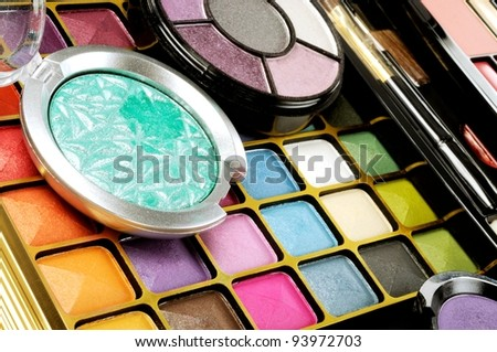 Lot of decorative colorful makeup sets , close up shot - stock photo