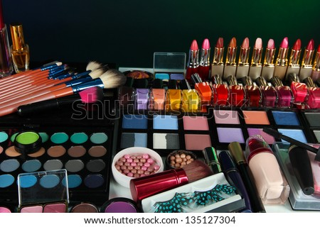Lot of different cosmetics on green background
