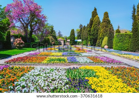 Lot of Different Kinds of Flowers in the Garden - stock photo