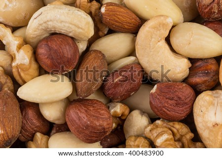 lot of different types of nuts mix for background - stock photo