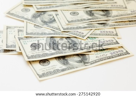 lot of 100 dollar bills on a white background - stock photo