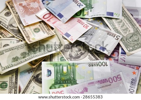 Lot of dollars and euros. Background and texture - stock photo