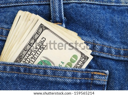 Lot of dollars in a pocket of jeans. - stock photo