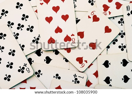 Lot of dusty old playing cards - stock photo