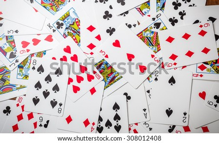 Lot of dusty old playing cards. - stock photo