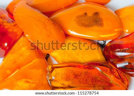 Lot of  genuine Baltic amber brooches - stock photo