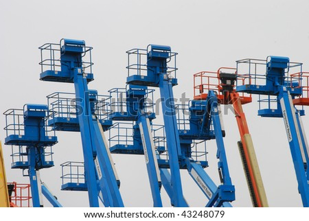 Lot of Lifts in a rental yard awaiting construction customers. - stock photo