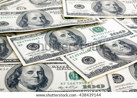 Lot of one hundred dollar bills close-up background. - stock photo