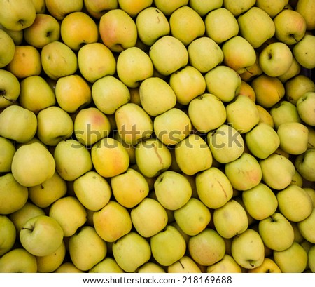 Lot of organic golden apples at market. Healthy food, lifestyle concept  - stock photo