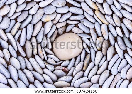 Lot of pebbles around big stone - stock photo