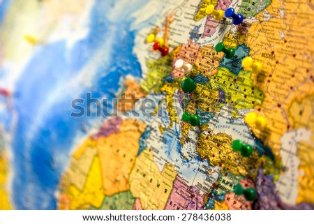 Lot of push pins pointing at European countries, Russian map. - stock photo