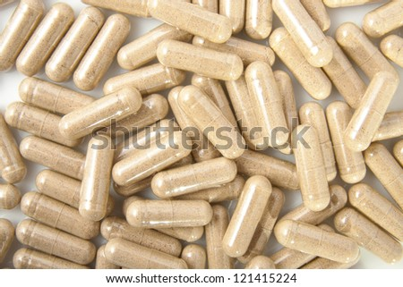 Lot of shiny brown capsules for background use - stock photo