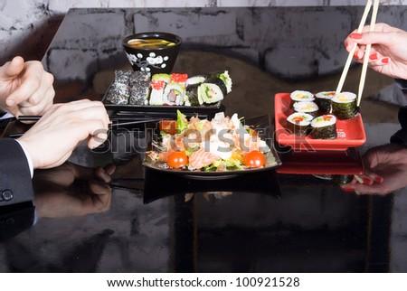 lot of sushi - stock photo