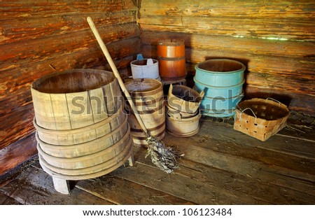 lot of tuns in interior of log cabin - stock photo
