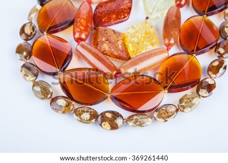 Lot of yellow beads from different minerals and stone background - stock photo
