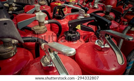Lot used fire extinguishers as background, close up