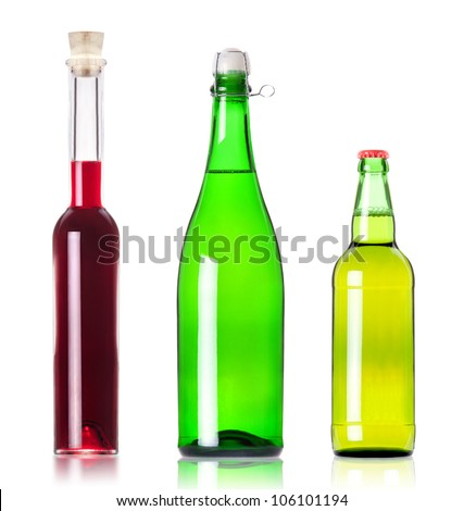 Lots bottles of various alcoholic drinks isolated over white background - stock photo